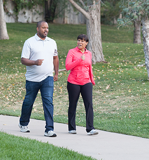 Man and woman walking in park.